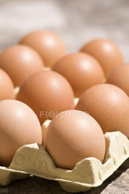 Chicken eggs in cardboard box — Stock Photo