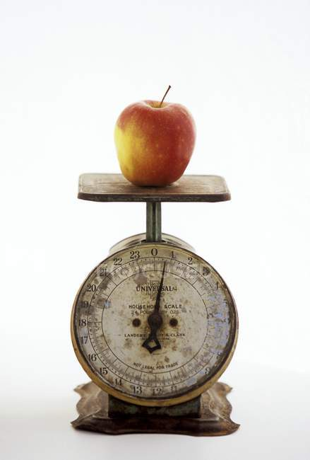 Apple on Metal Scale — Stock Photo