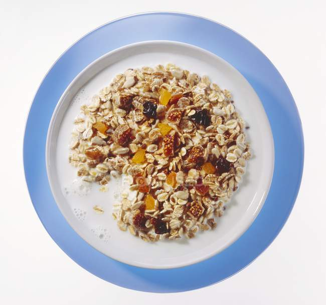 Muesli with dried fruits and milk — Stock Photo