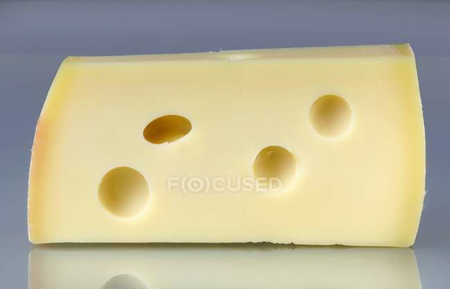 Piece of Emmental cheese — Stock Photo