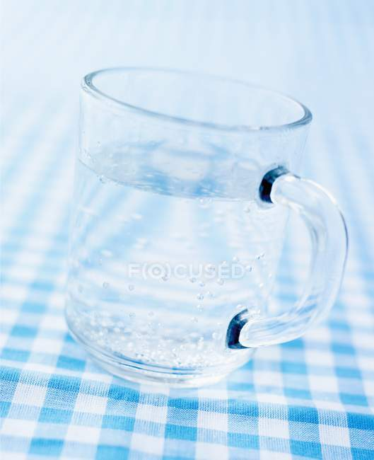 Closeup view of glass mug of mineral water — Stock Photo