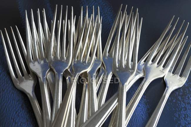 Closeup view of metal forks in heap — Stock Photo