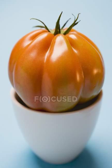 Red Tomato in bowl — Stock Photo
