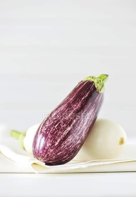 Striped purple and white aubergines — Stock Photo
