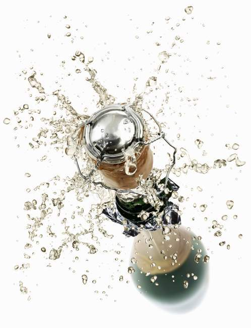 Cork flying out of a sparkling wine bottle — Stock Photo