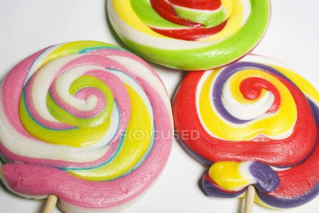 Three coloured lollipops — Stock Photo