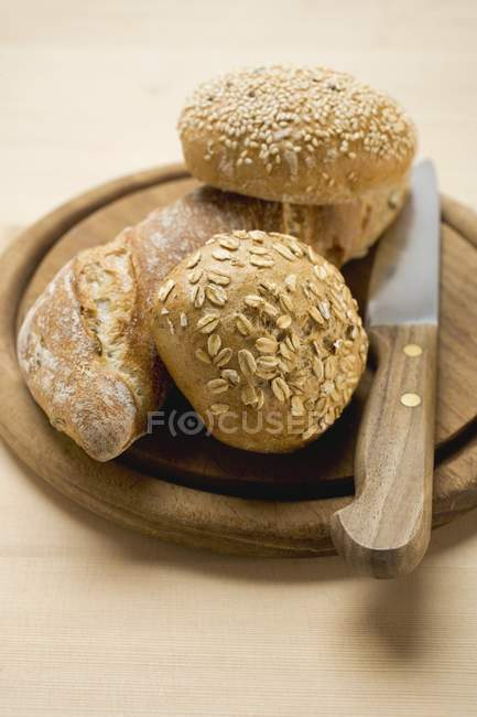 Baguette and wholemeal rolls — Stock Photo