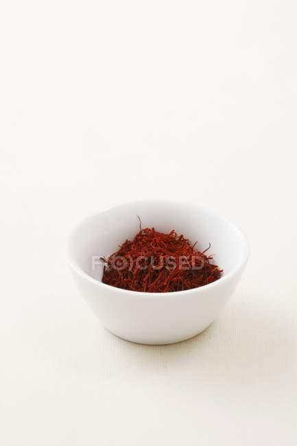 Bowl of saffron threads — Stock Photo