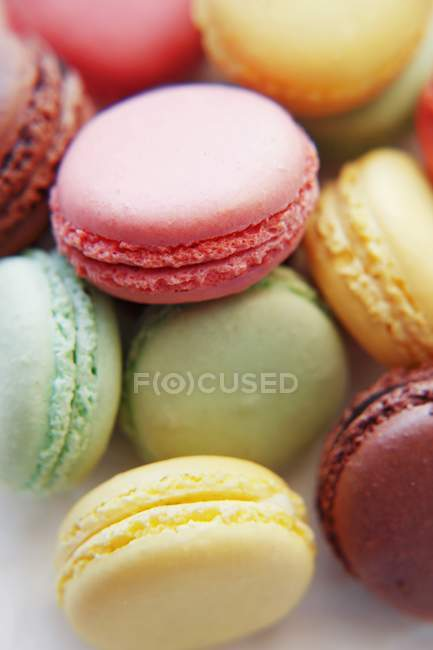 Coloured macarons in heap — Stock Photo