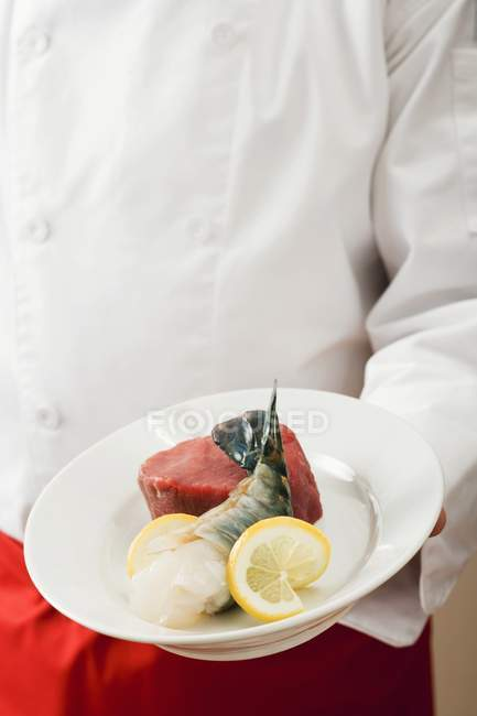 Chef holding beef fillet — Stock Photo