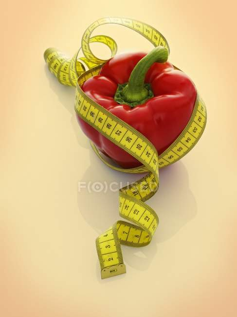 Red pepper with tape measure — Stock Photo