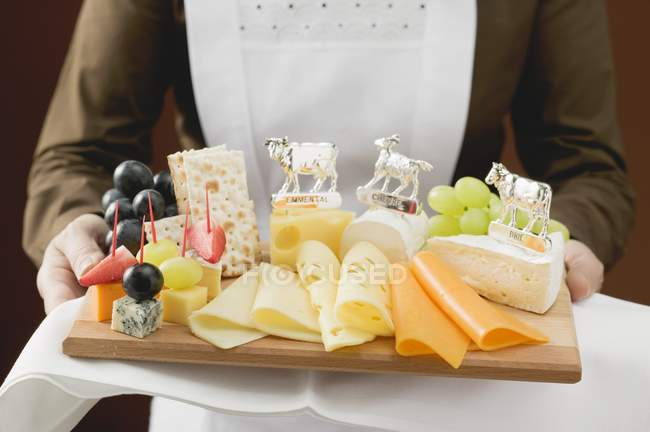 Waitress serving platter — Stock Photo