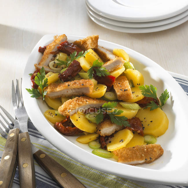 Chicken escalope with baked potatoes — Stock Photo