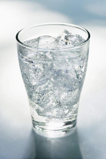 Glass of mineral water with ice cubes — Stock Photo