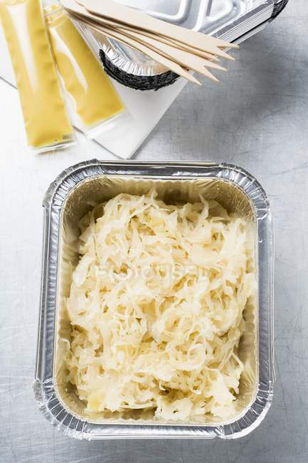 Sauerkraut in aluminium container to take away — Stock Photo