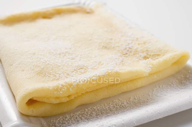 Crepe with icing sugar — Stock Photo