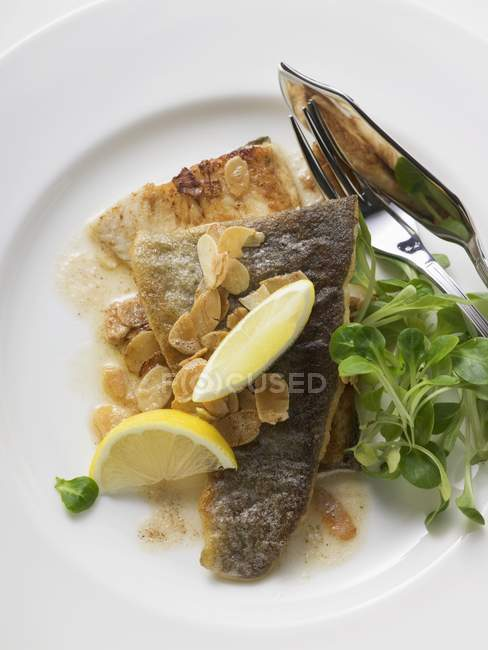 Fried trout with flaked almonds — Stock Photo