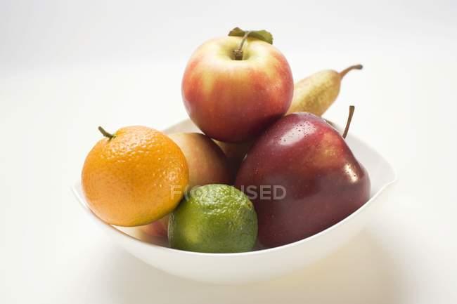 Яблоки и цитрусовые — стоковое фото
