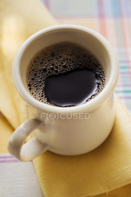 Mug of black coffee — Stock Photo