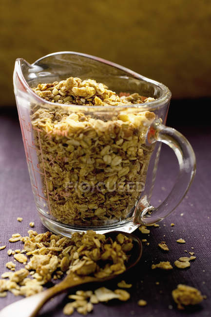 Crunchy muesli in measuring jug — Stock Photo