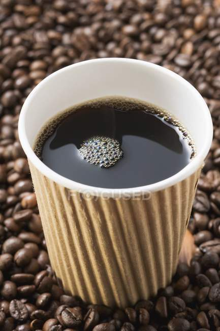 Black coffee in paper cup — Stock Photo