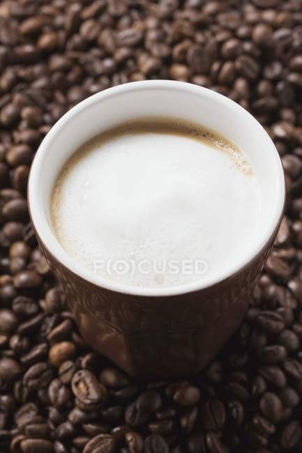 Cup of coffee with milk froth — Stock Photo