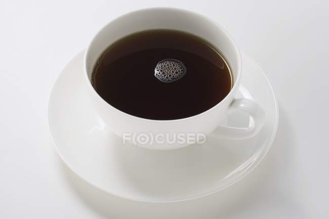 Black coffee in white cup — Stock Photo