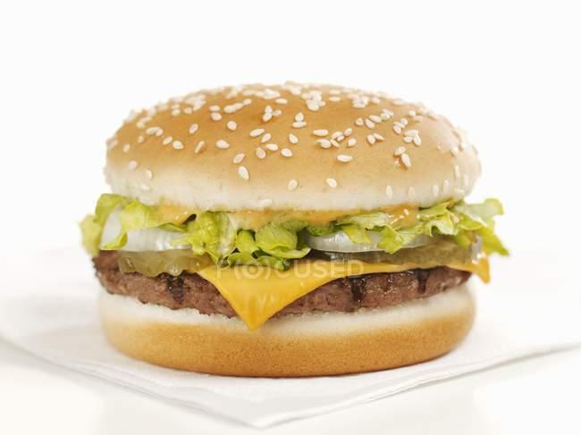 Cheeseburger on paper napkin — Stock Photo