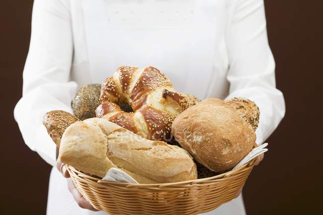Woman holding bread basket — Stock Photo