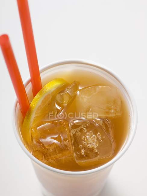 Iced tea with lemon in plastic cup — Stock Photo