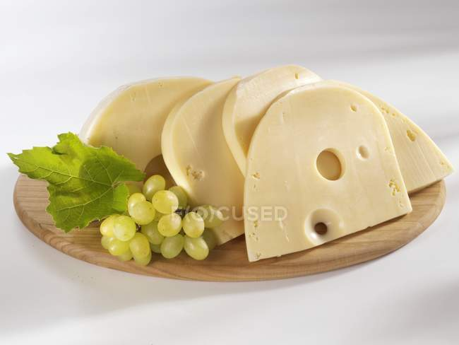 Swiss cheese with grapes — Stock Photo
