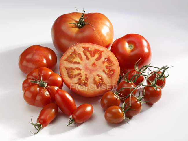 Various types of red tomatoes — Stock Photo