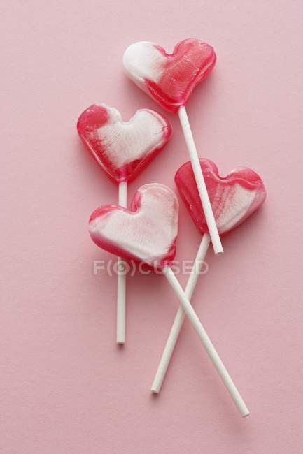 Four heart-shaped lollipops — Stock Photo