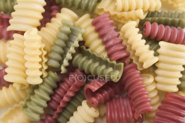 Closeup view of colored Riccioli pasta curls — Stock Photo