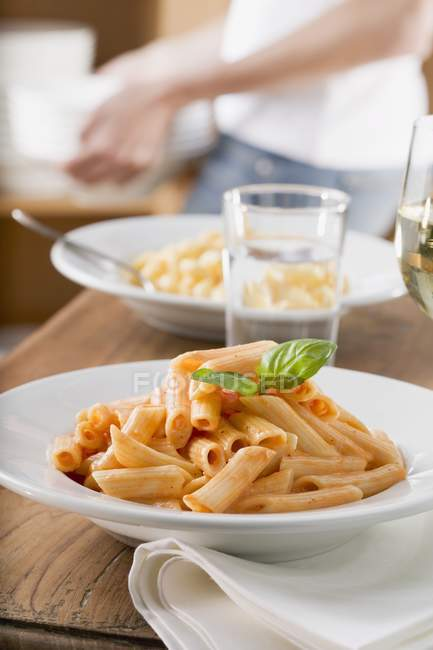 Penne with tomato sauce and basil — Stock Photo