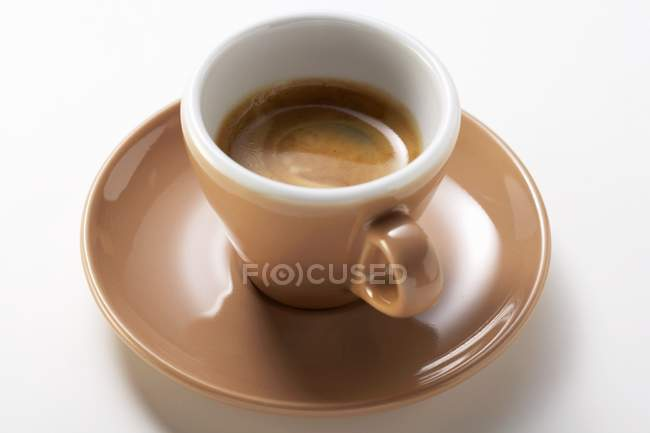 Brown cup of hot espresso — Stock Photo