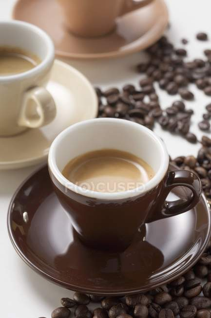 Cups of espresso and coffee beans — Stock Photo
