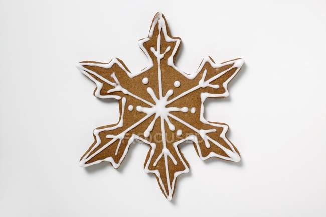 Gingerbread snowflake on white — Stock Photo