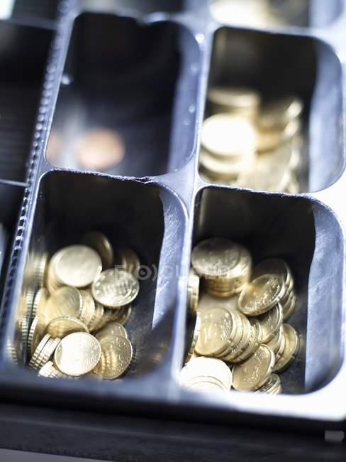 Closeup view of opened till with euro coins in sections — Stock Photo