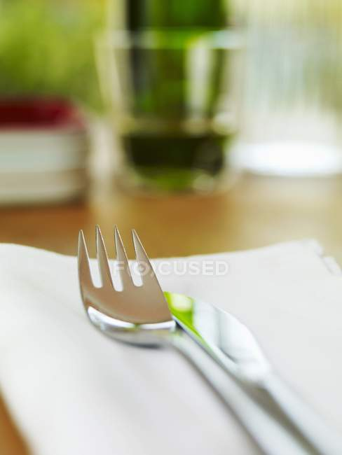 Closeup view of knife and fork on a fabric napkin — Stock Photo