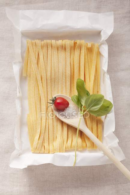 Tagliatelle pasta and tomato — Stock Photo