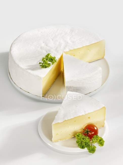 Camembert garnished with parsley — Stock Photo