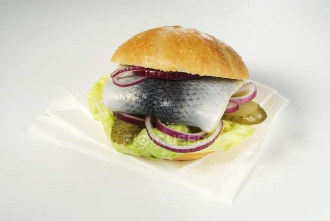 Herring roll with red onions — Stock Photo