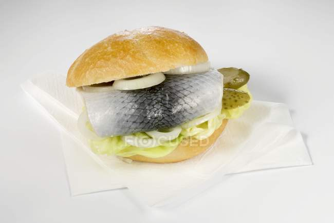Herring roll with gherkin and onion — Stock Photo