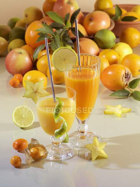 Fruit juice served in glasses — Stock Photo
