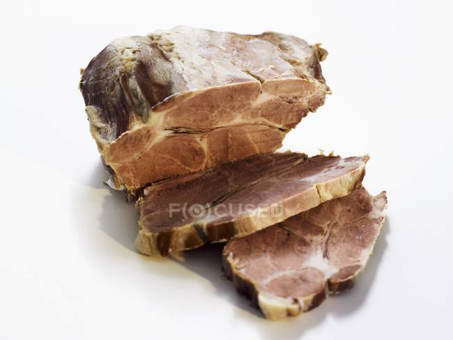 Partly sliced Cooked pork — Stock Photo
