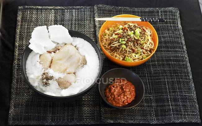 Chicken in salt crust with noodles — Stock Photo