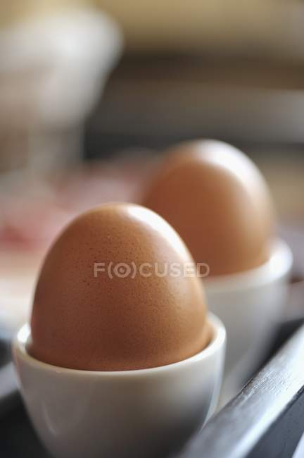 Egg cups on tray — Stock Photo