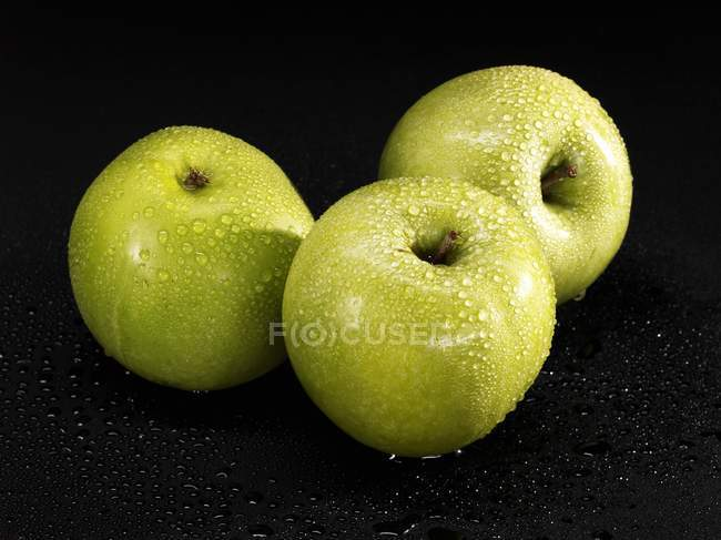 Tre mele Granny Smith — Foto stock