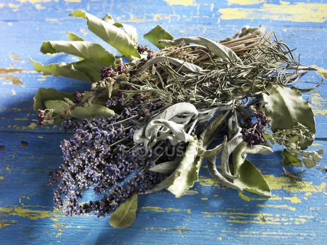 Closeup view of dried herbs heap on wooden surface — Stock Photo
